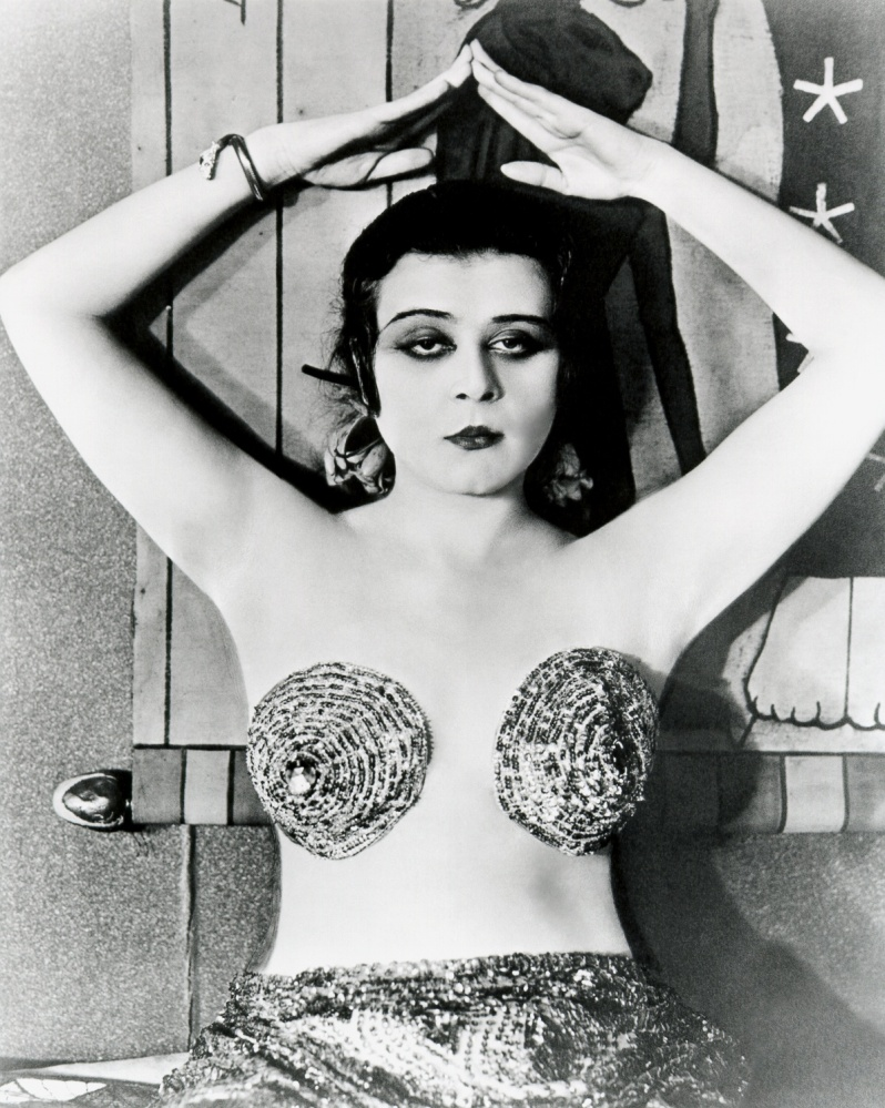 "Theda Bara wears a risque costume known as ""a dare"""