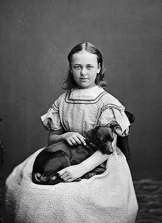 Portrait of a girl with a dog. Stockholm 1865-1875