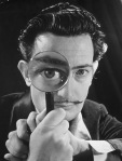 Salvador Dali with magnifying glass photographed in 1946 by Phillipe Halsman