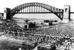 Astoria public pool with the Hell Gate railroad bridge looming in the background in the summer of 1940.