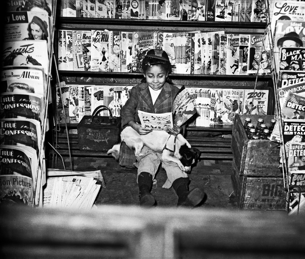 "Girl reading Mickey Mouse and the Submarine Pirates comic book in newsstand photographed by Charles ""Teenie"" Harris, 1947"