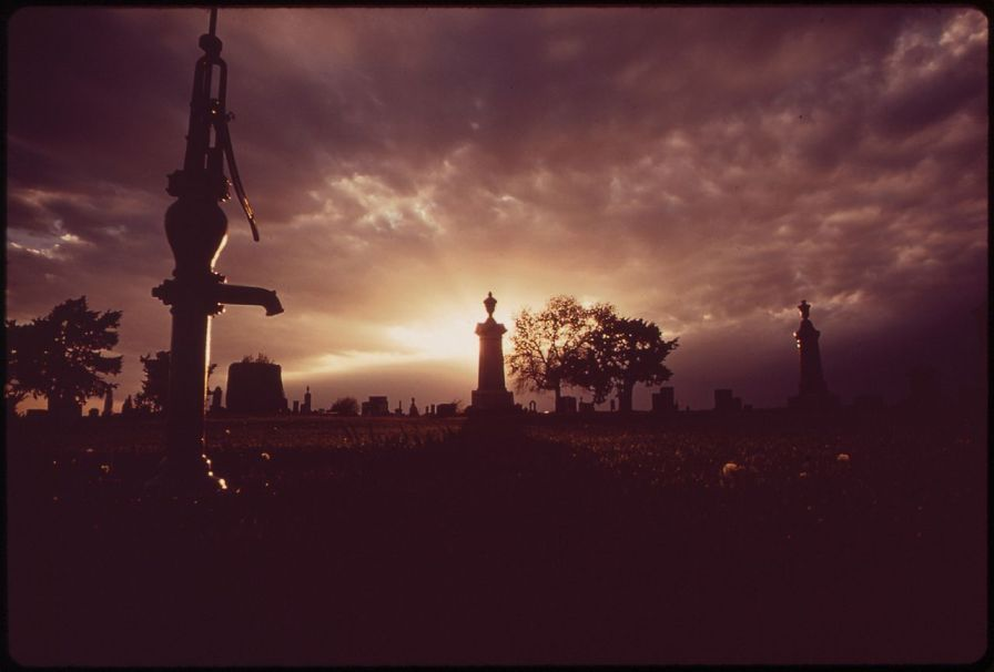Sun streaming through storm clouds at Grafton Cemetery, photographed by Charles O'Rear in May, 1973.