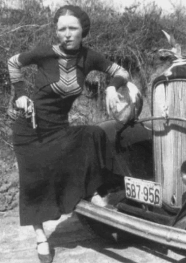 Bonnie Parker with cigar in Front of a Stolen Ford 1933