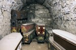 Coffins in the Vaults under St Michan's Church Dublin, photographed by Foxhunter22, March 2012, via Wikipedia