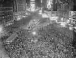Bettman-Corbis Vintage NYE Photograph 'As the clocks struck twelve on New Year's Eve in 1937,thousands of people inundated Times Square with cowbells, noisemakers, and streamers' via DailyMail