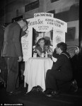 Bettman-Corbis Vintage NYE Photograph 'Hangover booth for revelers who go to far on New Years Eve has been set up at the Cafe Zanzibar in 1945' via DailyMail