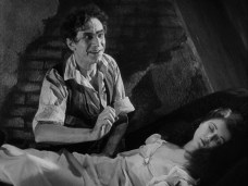 Bela Lugosi and Sydney Fox in 1932's Murders in the Rue Morgue