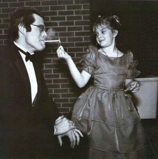 Drew Barrymore lights Stephen King's cigarette at the 1984 premiere of Firestarter in Bangor, Maine