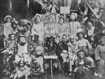 A group of masked and costumed Mardi Gras revelers on Frenchman Street, New Orleans in 1910. Photograph by John N. Teunisson.