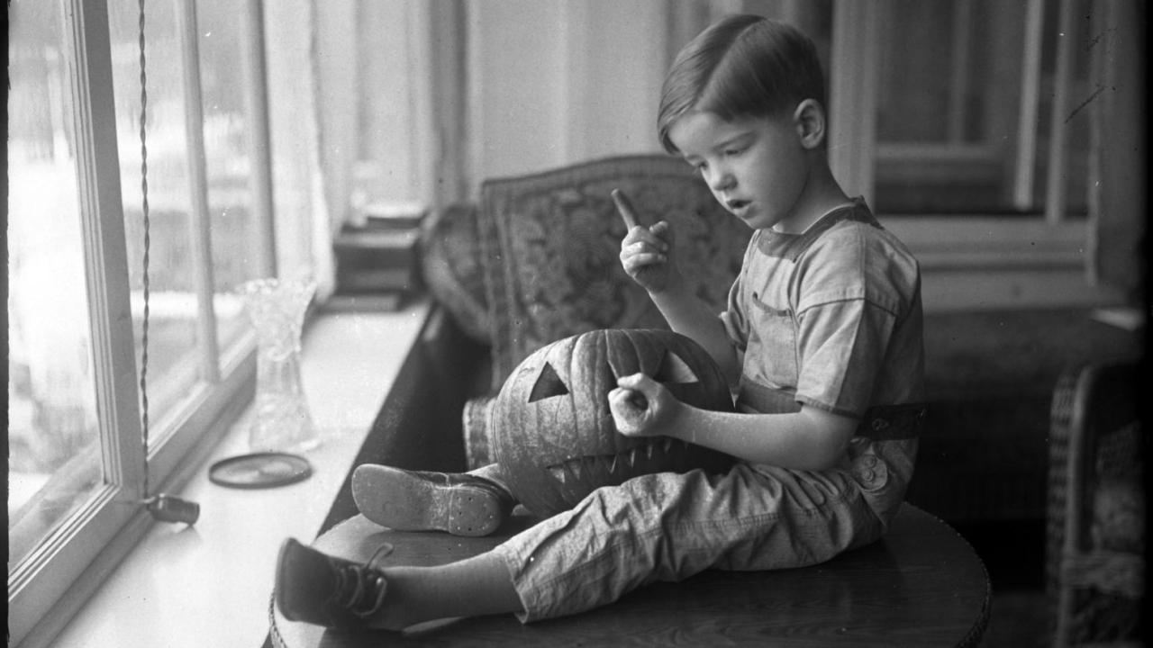 Young man explains the best way to carve a jack-o-lantern, Chicago, 1925evahalloween